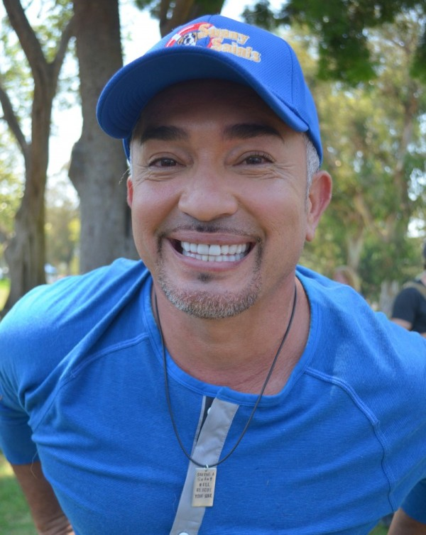 Cesar Millan wearing Nair & Bjorn dog tag